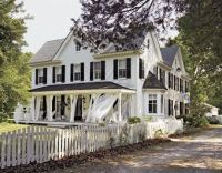 White House; black shutters; wrap around porch with tin ...