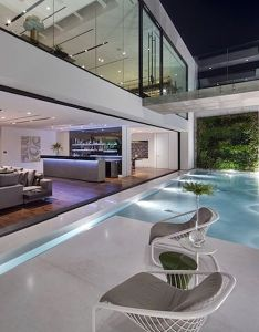 infinity pool blends perfectly with the use of glass walls in this contemporary home all throughout feeling fluidity and continuity also amazing via luxuryworldtraveler luxuryrealestate luxury rh pinterest