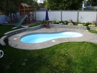 The family area with the pool and lawn, is separated from ...