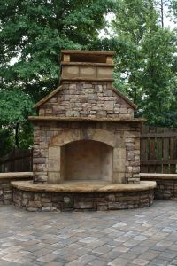 Stacked Stone Outdoor Fireplace with Hearth and Seating ...