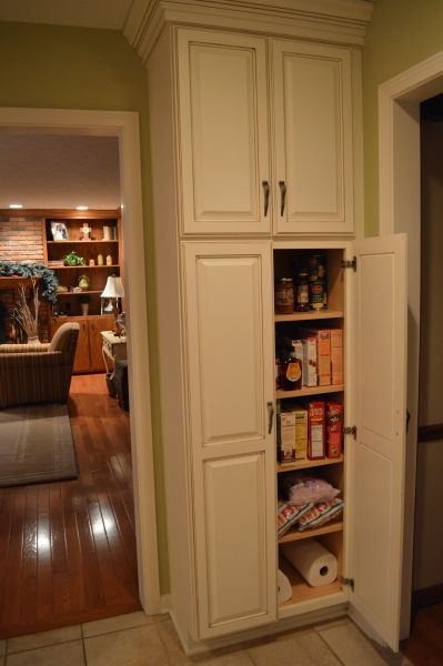 corner kitchen pantry cabinet Simple white kitchen pantry cabinet from timber set on the