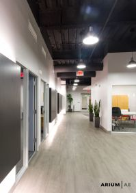 Corridor in an office space, with black laminate accent ...