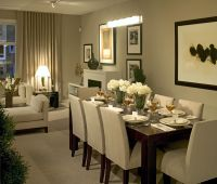 This cozy dining room seats eight guests, perfect for ...