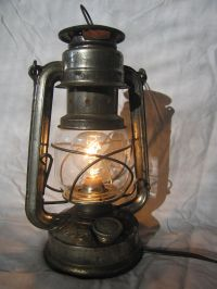 Convert a kerosene lantern into an electric lamp. Yes ...