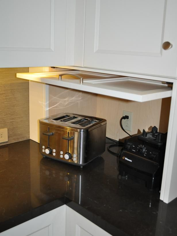 Hide your kitchen appliances with a garage style cabinet