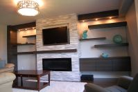 Wall mounted fireplace and floating cabinet and shelves ...