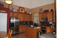 red accent wall in kitchen with brown cabinets - Google ...