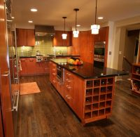 Contemporary mahogany kitchen and island. So I can see ...