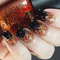Halloween glitter gradient nail art.