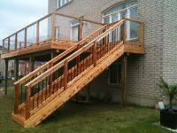 Second story cedar deck and stairs with glass railing ...
