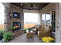 ***flat-screened TV over fireplace in Outdoor Dining Room ...