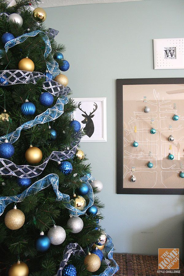 christmas decorating in blue and gold we love the ornaments attached to the framed tree