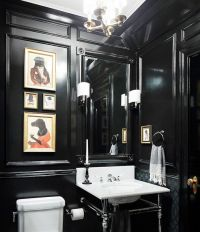 sophisticated and elegant black powder room with wall ...