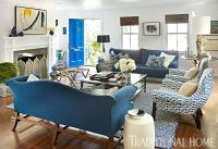 A Chippendale sofa sits harmoniously next to a pair of ...