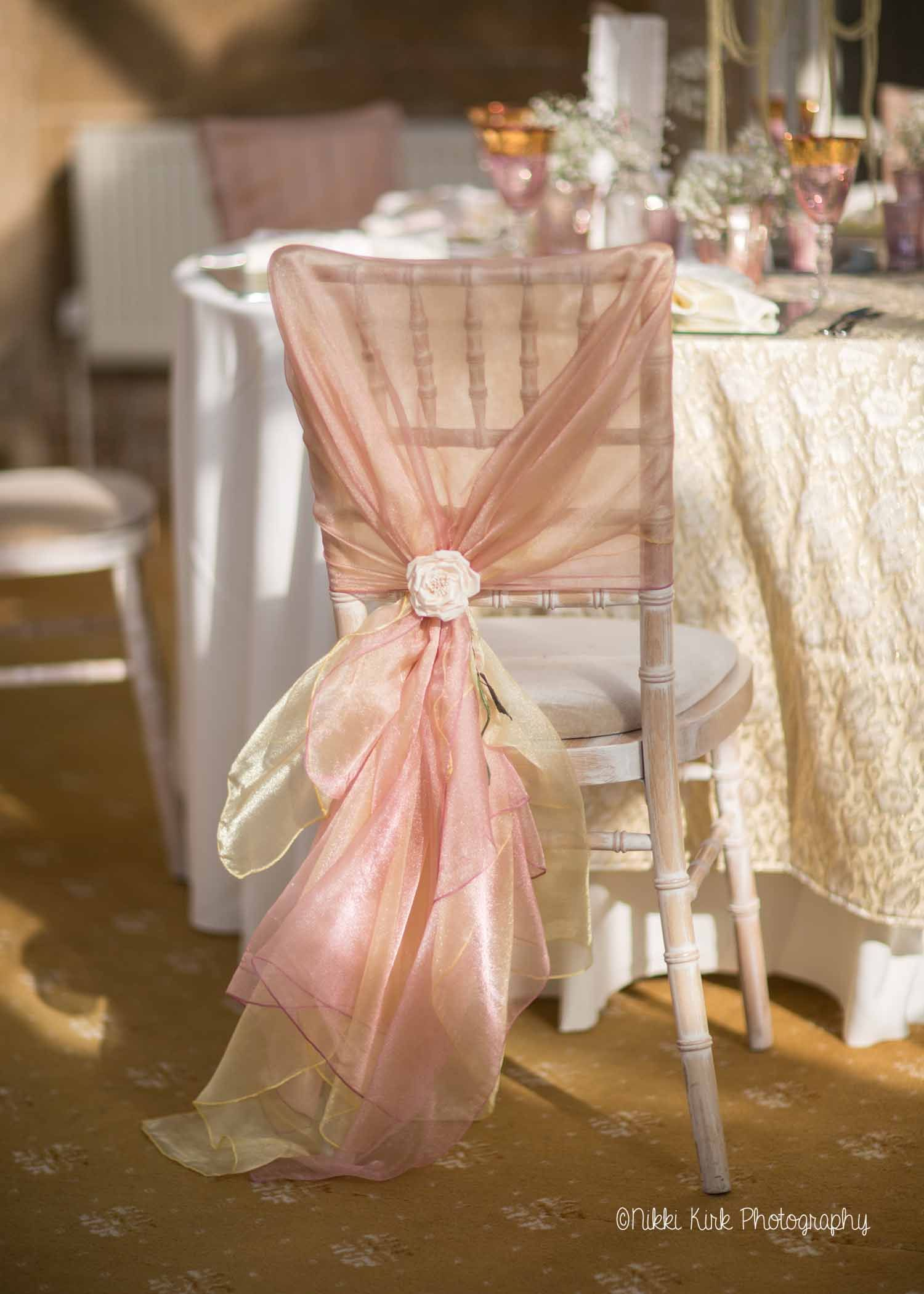 gold chair covers with black sash behind the ombre a limewash chiavari hand tied dusky pink and