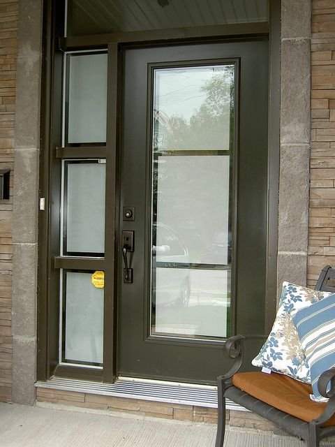Front door and sidelight with privacy frosted film on