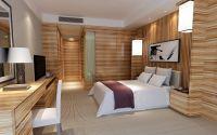 Single hotel mock-up room with light zebrano finish ...