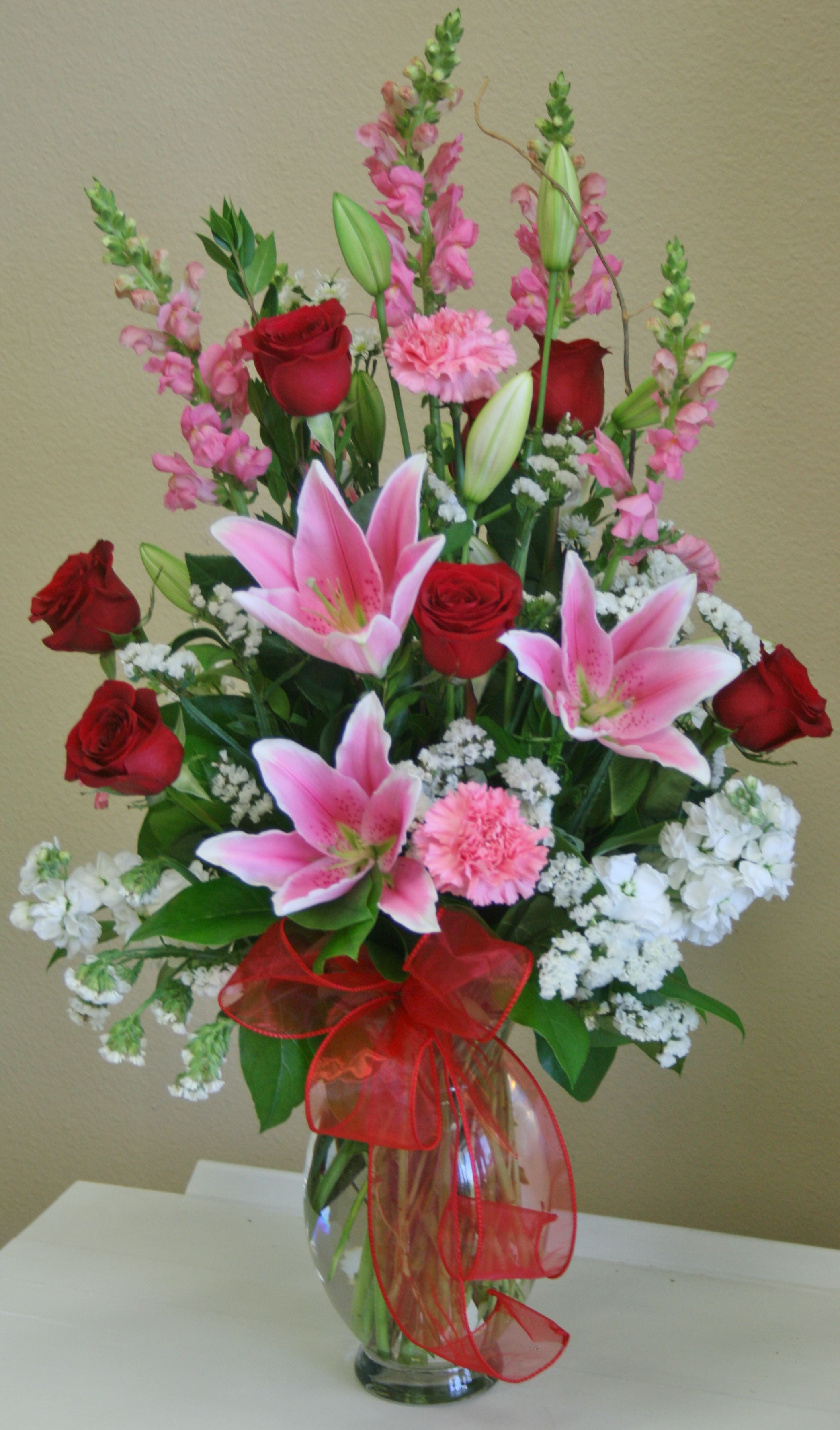 A Romantic Red White And Pink Flower Arrangement By Your