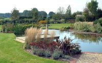 easy+landscape+for+a+large+pond   Large Pond and Plantings ...