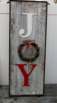 Rustic barn wood look Joy sign has a decorated wreath in ...