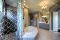 Spa master bath with walk through shower, garden tub and