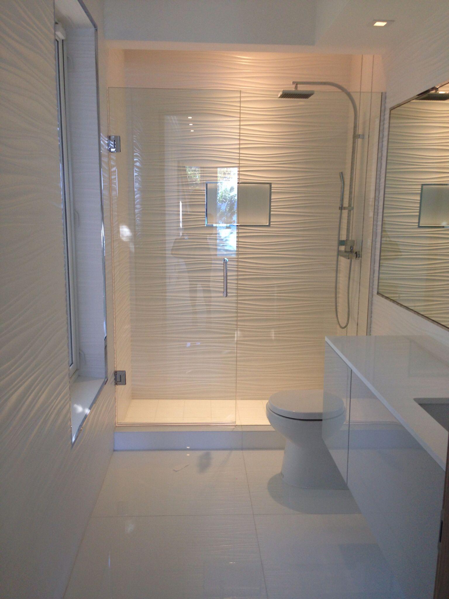 All white bathroom...gorgeous! Wall tile, toilet, vanity