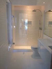 All white bathroom...gorgeous! Wall tile, toilet, vanity