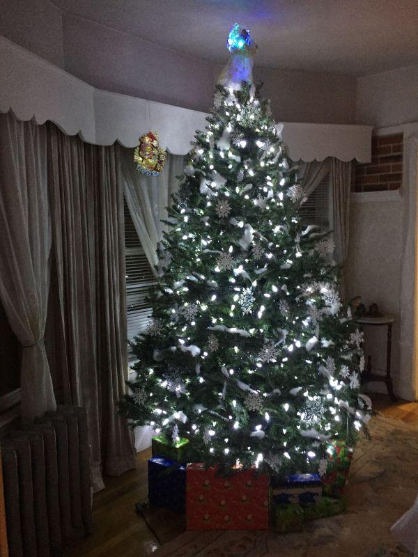 Snow flake theme Christmas tree with fake snow and Philips