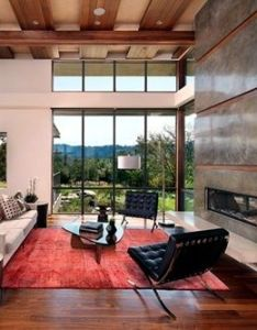 Classy family room deisgn of portola valley residence tobin dougherty architects with white sofa and balck desgn on red rug also basic principles for contemporary decor home pinterest rh za