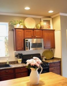 Simple decorating above kitchen cabinets also decor pinterest rh