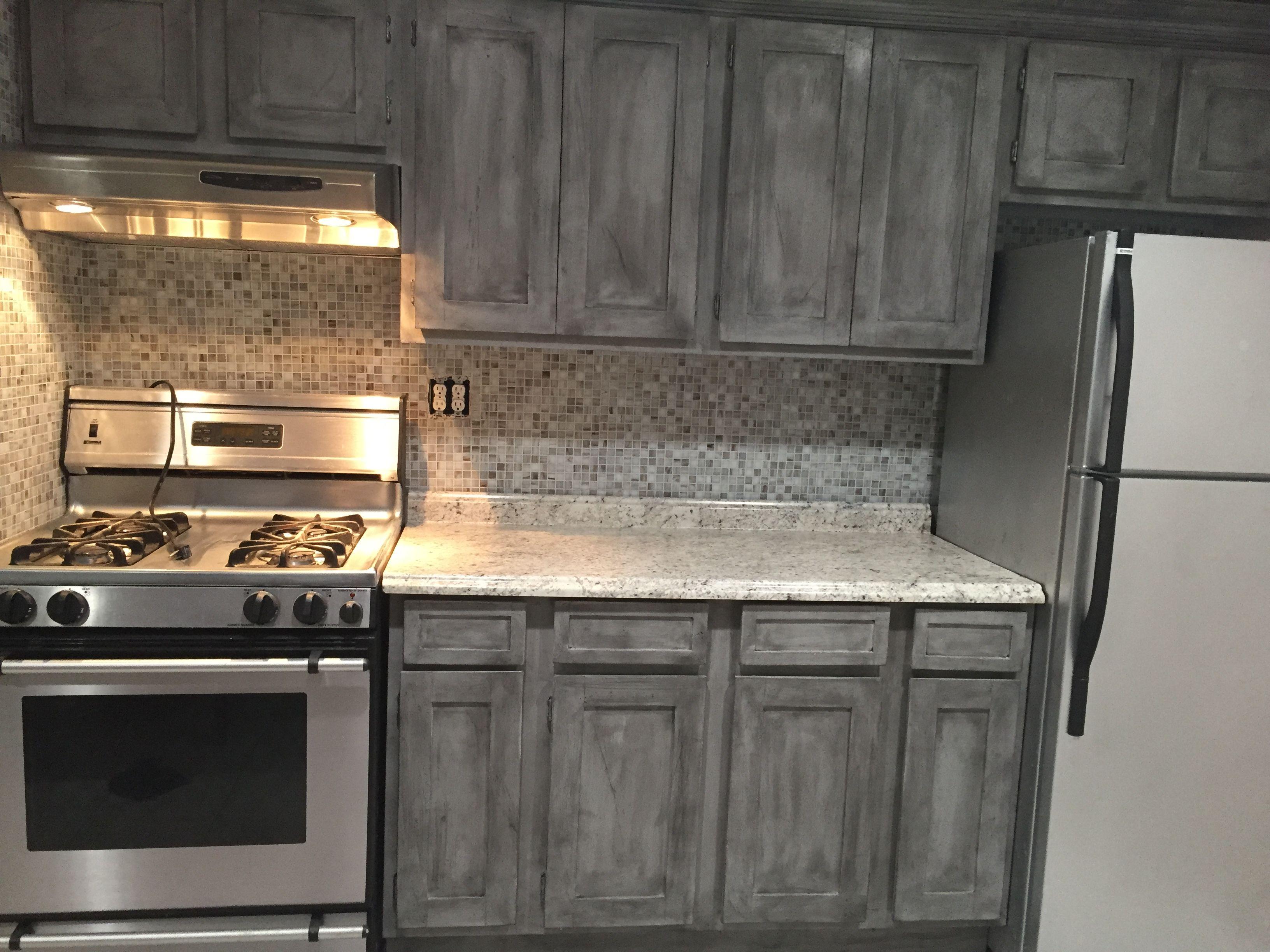 Annie Sloan Paris Grey with black wax on kitchen cabinets