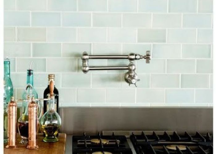 Blue subway tiles transitional kitchen decor de provence beautiful glass backsplash pot filler and copper pepper mills also soft handmade ceramic tile adds  lot of character to this