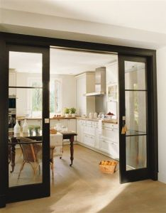 Black pocket kitchen doors iding space from formal living room dining and family also blanco roto shabby chic vintage el mueble revista de rh pinterest