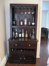 Custom liquor cabinet with glass racks, open shelving