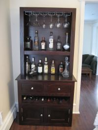Custom liquor cabinet with glass racks, open shelving ...