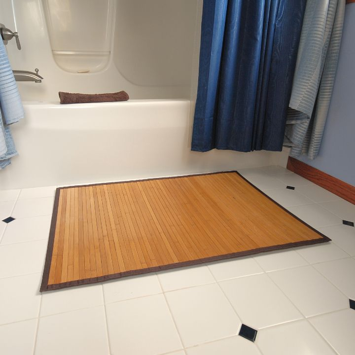 try using a bamboo rug in the bathroom, so easy to clean. | rugs