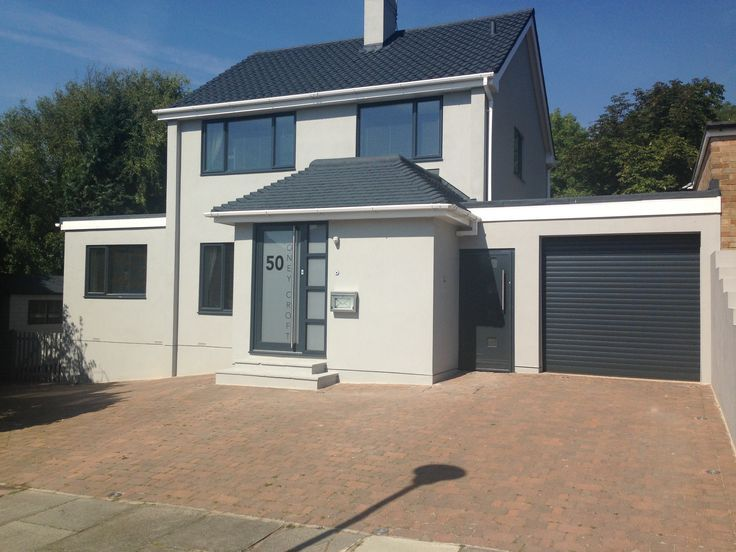 After Picture White Rendered House With Grey Windows And Grey Roof