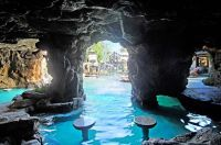 Pool cave behind a waterfall with seating. | Pools & Spa ...