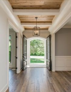 Beautiful home interior love those hardwood floors and beams on the ceiling also rh pinterest