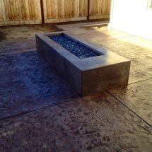 Stamped Patio With Concrete Fire Pit. Gas Burners