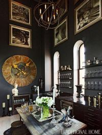 A wine room is furnished with a large antique bronze clock
