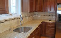 Travertine subway tile kitchen backsplash with a glass ...