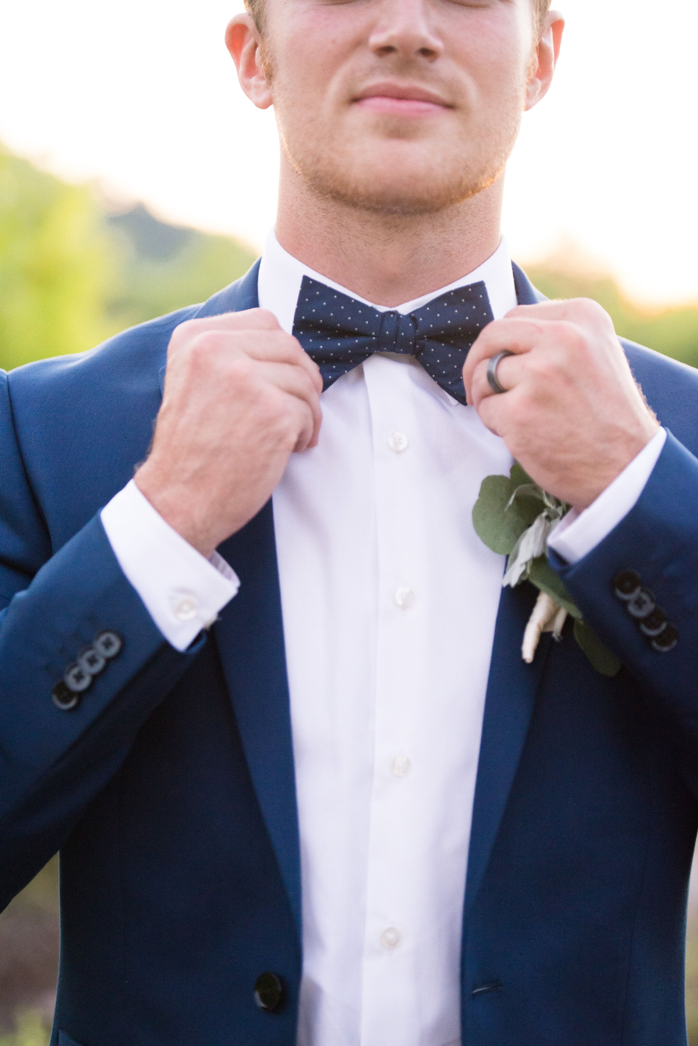 Navy blue grooms attire. Bow tie and navy blue suits are