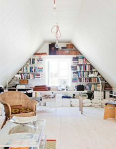 Simple attic home office with  wall bookcase around the window modern living design ideas also love attics that are redone into great uses of space this is no rh pinterest