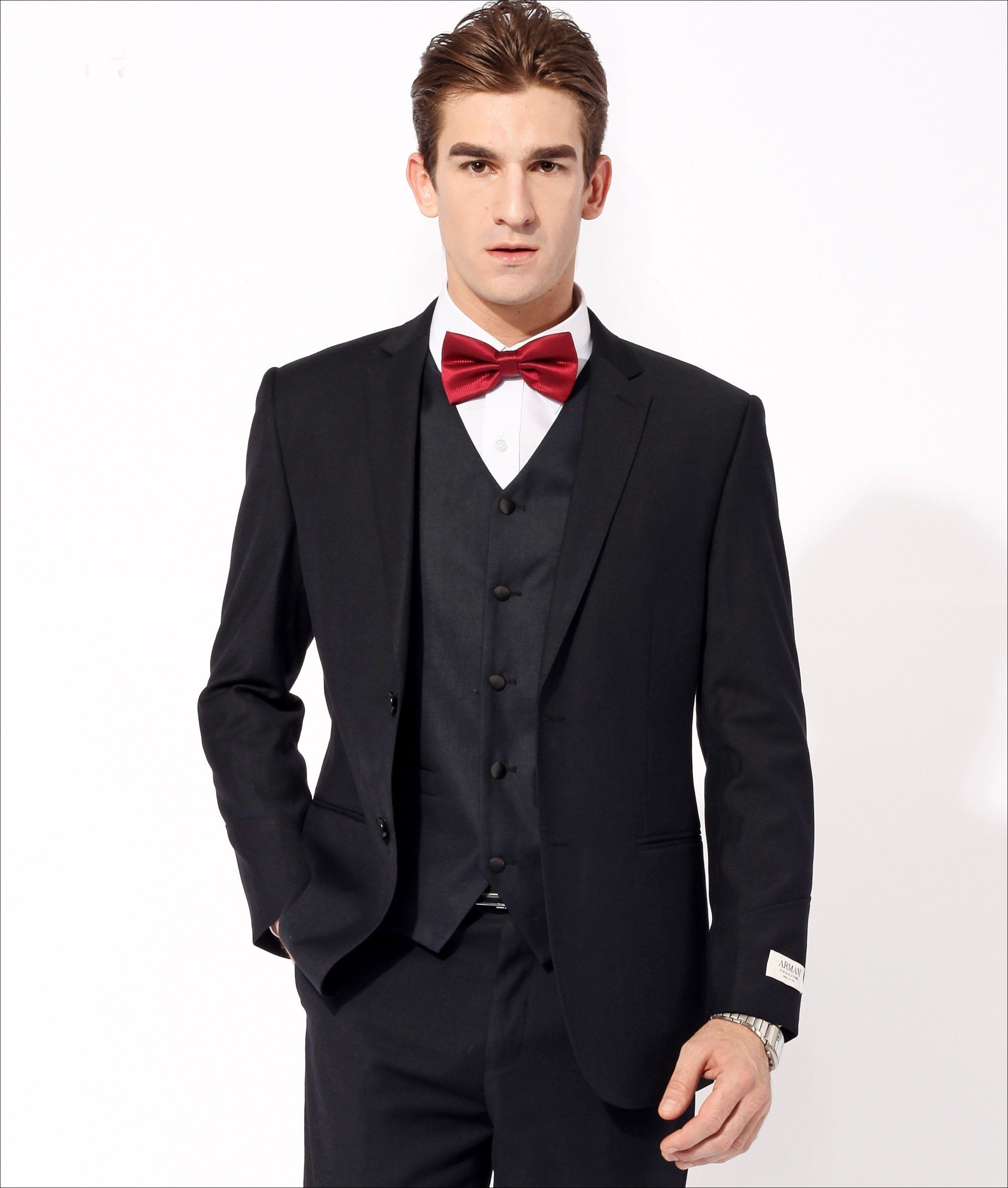 man in black suit with red bow tie