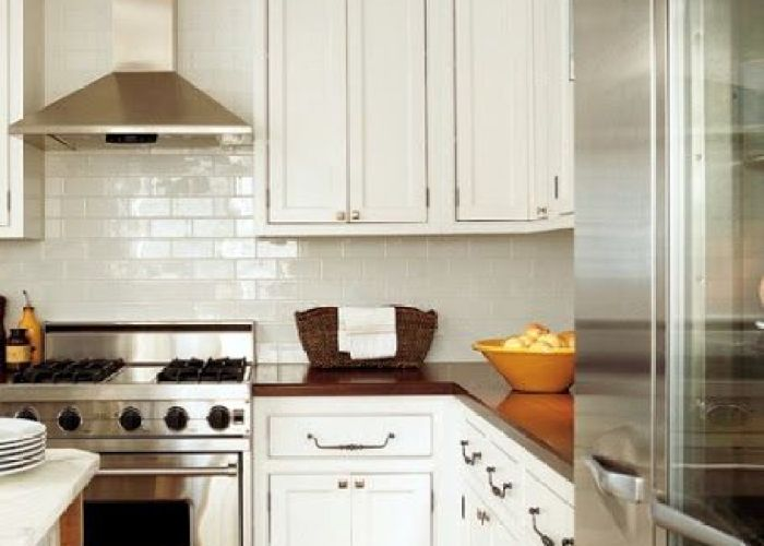 Stainless steel range hood with white subway tile back splash and cabinets also lauren liess pure style home kitchens pinterest