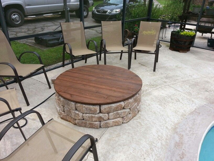 This is our firepit with a gas insert and a wooden cover