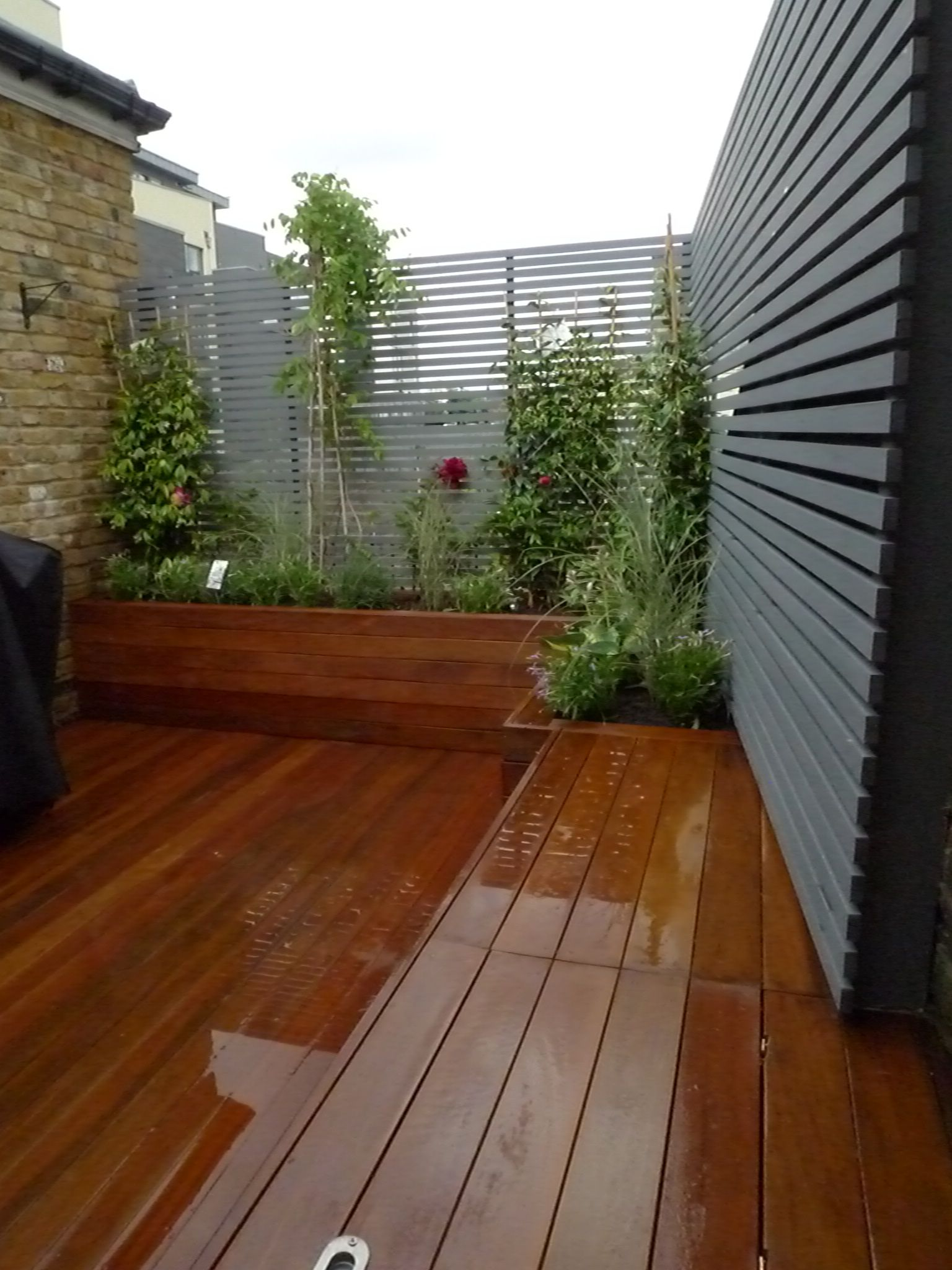 Place Lined Enclosures In The Corner Of A Deck Patio Or On A