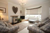 Cosy contemporary country living room with tartan check ...