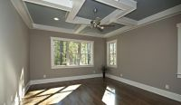 dark wood floors, tan walls, white crown molding, tray ...